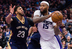Sacramento Kings forward DeMarcus Cousins (15) passes the ball against New Orleans Pelicans forward Anthony Davis (23) during the fourth quarter at Golden 1 Center.
