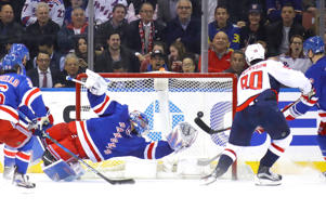 The Capitals' Marcus Johansson scores against the Rangers' Henrik Lundqvist on Feb. 28 in New York.