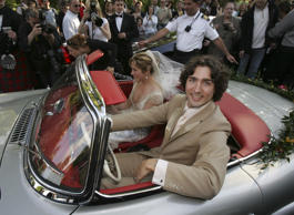 Justin Trudeau and bride Sophie Gregoire leave the Sainte-Madeleine D'Outremont Church, Montreal, after their wedding ceremony here, May 28, 2005. The car a 1959 Mercedez 300SL, was Pierre Trudeua's car and was recently renovated