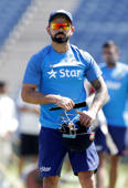 India's captain Virat Kohli looks at his team members during a practice session.