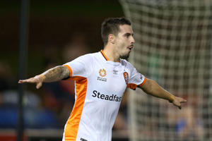 Jamie Maclaren of the Roar celebrates a goal during the round 22 A-League match between the Newcastle Jets and the Brisbane Roar.