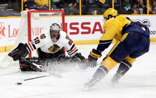 Chicago Blackhawks goalie Corey Crawford (50) follows the puck as Nashville Predators right wing James Neal (18) closes in during the second period of an NHL hockey game Saturday, March 4, 2017, in Nashville, Tenn.