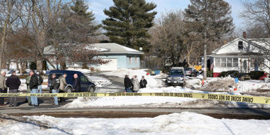 State and Peabody police investigate the scene of a double homicide (in the house at right) on Farm Avenue in Peabody, MA on Feb. 19, 2017.