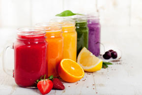 Smoothies, juices, beverages, drinks variety with fresh fruits and berries on a ...