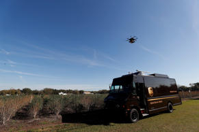 A drone demonstrates delivery capabilities from the top of a UPS truck during testing in Lithia, Florida, U.S. February 20, 2017.
