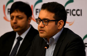 Kunal Bahl, Co-founder and CEO, Snapdeal (R) is watched by Amit Agarwal, Country Head Amazon India as he speaks during a press conference on Model GST Law (TCS) for the e Commerce Sector in New Delhi