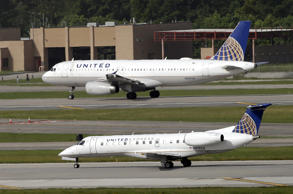 A July 8, 2015, file photo of United Airlines and United Express planes.