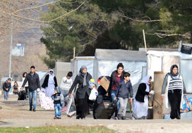 "<span style=""color:#333333;font-family:Arial, Helvetica, Verdana, sans-serif;font-size:13.2px;"">Yazidi refugees carry their belongings on January 3, 2017 in Diyarbakir, southeastern Turkey </span>"