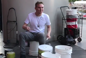 Street performer takes bucket drumming to a whole new level
