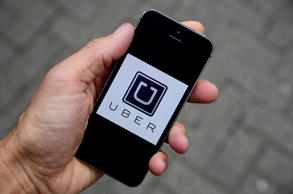 The Uber app logo is seen on a mobile telephone in this October 28, 2016 photo illustration.