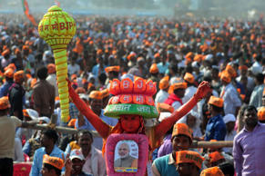 Supporters of India's Bharatiya Janata Party (BJP) listen to BJP Leader and Indian Prime Minister Narendra Modi