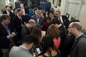 Reporters talk after failing to get access to an off-camera briefing with White ...