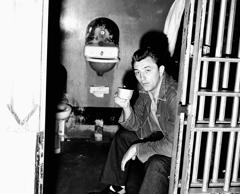 Movie star Robert Mitchum sips a cup of soup in his cell in the Los Angeles County jail as he begins a 60 day sentence for conspiracy to possess marijuana. A faded blue denim shirt replaced the natty business suit he wore to court on Feb. 10, 1949, but he still had on his own argyle socks.