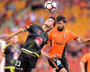 Thomas Broich of the Roar and Matthew Ridenton of the Phoenix challenge for the ball during the round 21 A-League match between the Brisbane Roar and the Wellington Phoenix