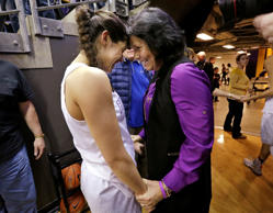 Washington's Kelsey Plum, left, is greeted by her mother, Katie Plum, after the team's NCAA college basketball game against Utah on Saturday in Seattle. Plum scored 57 points and set the all-time career NCAA scoring record at 3,397 points during the game. The Washington won 84-77.