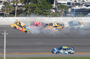 Kyle Busch, driver of the #18 M&M's Toyota, Erik Jones, driver of the #77 5-hour Energy Extra Strength Toyota, Matt Kenseth, driver of the #20 DeWalt Toyota, and Ty Dillon, driver of the #13 GEICO Chevrolet, are involved in an on-track incident during the Daytona 500 on Feb. 26, 2017.