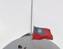 A police officer raises the national flag to half-mast, marking the date of the 228 Incident, a grassroots uprising against mainland Chinese, on Saturday, Feb, 28, 2009, in Taipei, Taiwan. The 228 Incident, also known as the 228 Massacre, was an anti-government, anti-Chinese uprising in Taiwan that began on February 28, 1947, and was violently suppressed by the Kuomintang (KMT) government.