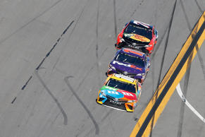 Kyle Busch, driver of the #18 M&M's Toyota, leads Denny Hamlin and Martin Truex Jr. during the 59th Annual DAYTONA 500 at Daytona International Speedway on February 26, 2017.