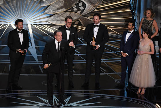 "Slide 18 of 33: Visual effects supervisor Robert Legato (C) delivers a speech next to Adam Valdez, Andrew R. Jones and Dan Lemmon as they stand on stage next to British actor and rapper Riz Ahmed (3rdR) and US actress Felicity Jones (R) after they won the Best Visual Effects award for ""The Jungle Book"" at the 89th Oscars on February 26, 2017 in Hollywood, California. / AFP / Mark RALSTON (Photo credit should read MARK RALSTON/AFP/Getty Images)"