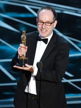 Slide 20 of 33: HOLLYWOOD, CA - FEBRUARY 26: Editor John Gilbert accepts Best Film Editing for 'Hacksaw Ridge' onstage during the 89th Annual Academy Awards at Hollywood & Highland Center on February 26, 2017 in Hollywood, California. (Photo by Kevin Winter/Getty Images)