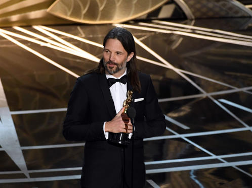 Slide 23 of 33: HOLLYWOOD, CA - FEBRUARY 26: Cinematographer Linus Sandgren accepts Best Cinematography for 'La La Land' onstage during the 89th Annual Academy Awards at Hollywood & Highland Center on February 26, 2017 in Hollywood, California. (Photo by Kevin Winter/Getty Images)