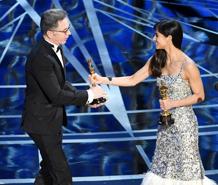 Slide 9 of 33: HOLLYWOOD, CA - FEBRUARY 26: Sound re-recording mixer Kevin O'Connell (L) accepts Best Sound Mixing for 'Hacksaw Ridge' from actor Sofia Boutella onstage during the 89th Annual Academy Awards at Hollywood & Highland Center on February 26, 2017 in Hollywood, California. (Photo by Kevin Winter/Getty Images)