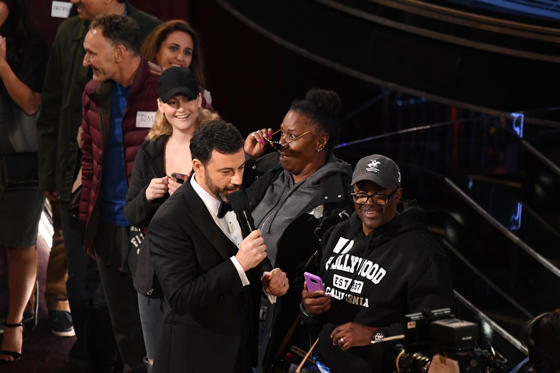 Slide 17 of 33: Feb 26, 2017; Hollywood, CA, USA; Jimmy Kimmel gives a pair of Jennifer Aniston's sunglasses to a woman who is part of a group of tourists from a sight seeing tour brought into the theatre during the 89th Academy Awards at Dolby Theatre. Mandatory Credit: Robert Deutsch-USA TODAY NETWORK