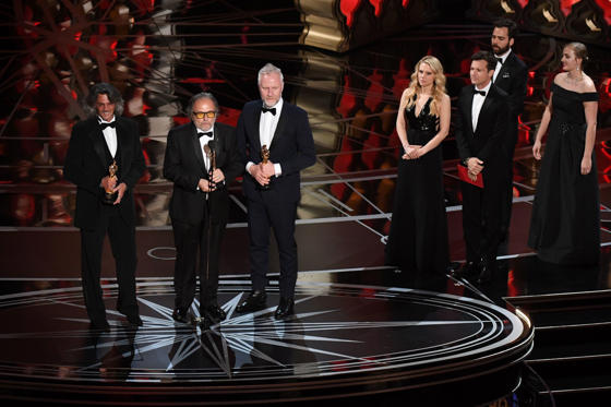 "Slide 4 of 33: Alessandro Bertolazzi (2ndL), Giorgio Gregorini (L) and Christopher Nelson (3rdR) accept the award for Best Makeup and Hairstyling in ""Suicide Squad"" next to US comedian Kate McKinnon (2ndR) and US actor Jason Bateman on stage at the 89th Oscars on February 26, 2017 in Hollywood, California. / AFP / Mark RALSTON (Photo credit should read MARK RALSTON/AFP/Getty Images)"