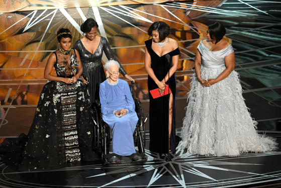 Slide 6 of 33: HOLLYWOOD, CA - FEBRUARY 26: NASA mathematician Katherine Johnson (2nd L) appears onstage with (L-R) actors Janelle Monae, Taraji P. Henson and Octavia Spencer during the 89th Annual Academy Awards at Hollywood & Highland Center on February 26, 2017 in Hollywood, California. (Photo by Kevin Winter/Getty Images)