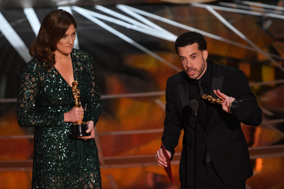 "Slide 7 of 33: US director Ezra Edelman (R) delivers a speech on stage next to producer Caroline Waterlow after they won Best Documentary Feature award for ""O.J. Made In America"" at the 89th Oscars on February 26, 2017 in Hollywood, California. / AFP / Mark RALSTON (Photo credit should read MARK RALSTON/AFP/Getty Images)"