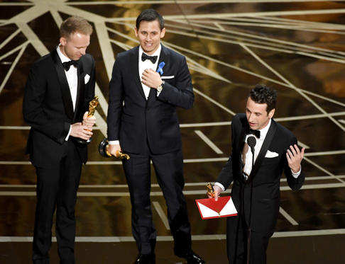 Slide 25 of 33: HOLLYWOOD, CA - FEBRUARY 26: (L-R) Songwriters Justin Paul, Benj Pasek and Justin Hurwitz accept Best Original Song for 'City of Stars' from 'La La Land' onstage during the 89th Annual Academy Awards at Hollywood & Highland Center on February 26, 2017 in Hollywood, California. (Photo by Kevin Winter/Getty Images)