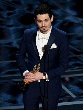 Slide 28 of 33: HOLLYWOOD, CA - FEBRUARY 26: Director Damien Chazelle accepts Best Director for 'La La Land' onstage during the 89th Annual Academy Awards at Hollywood & Highland Center on February 26, 2017 in Hollywood, California. (Photo by Kevin Winter/Getty Images)