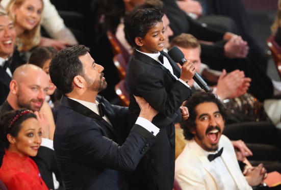 Slide 19 of 33: 89th Academy Awards - Oscars Awards Show - Hollywood, California, U.S. - 26/02/17 - Dev Patel watches Jimmy Kimmel lift Sunny Pawar. REUTERS/Lucy Nicholson
