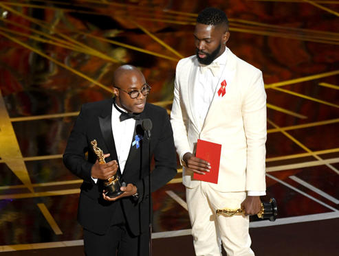 Slide 27 of 33: HOLLYWOOD, CA - FEBRUARY 26: Writer/director Barry Jenkins (L) and writer Tarell Alvin McCraney accept Best Adapted Screenplay for 'Moonlight' onstage during the 89th Annual Academy Awards at Hollywood & Highland Center on February 26, 2017 in Hollywood, California. (Photo by Kevin Winter/Getty Images)