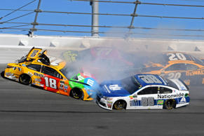 NASCAR Cup Series driver Dale Earnhardt Jr. (88) and NASCAR Cup Series driver Kyle Busch (18) wreck during the Daytona 500 on Feb. 26, 2017