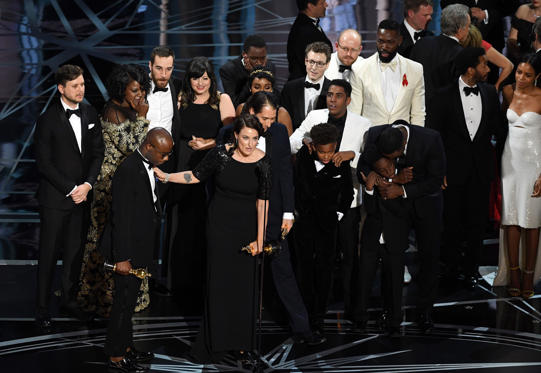 Slide 33 of 33: HOLLYWOOD, CA - FEBRUARY 26: Cast and crew of 'Moonlight' accept the Best Picture award onstage during the 89th Annual Academy Awards at Hollywood & Highland Center on February 26, 2017 in Hollywood, California. (Photo by Kevin Winter/Getty Images)