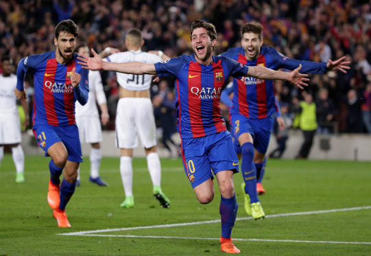 Slide 1 of 26: Barcelona's Sergi Roberto celebrates after scoring the sixth goal during the Champions League round of 16, second leg soccer match between FC Barcelona and Paris Saint Germain at the Camp Nou stadium in Barcelona, Spain, Wednesday March 8, 2017