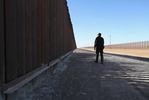 A U.S. Border Patrol agent stands at the U.S.-Mexico border fence on November 17, 2016 in San Luis, Arizona.
