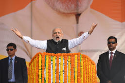 Indian Prime Minister Narendra Modi and Bharatiya Janata Party (BJP) leader (C) gestures as he addresses a state assembly election rally