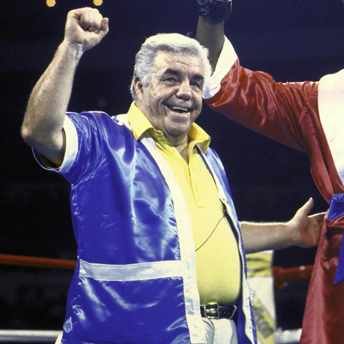 Slide 1 of 13: Cruiserweight Boxing: Evander Holyfield victorious with trainer Lou Duva after winning fight vs Lionel Byarm at Madison Square Garden, New York, NY 11/15/1984
