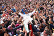 NORTHAMPTON, ENGLAND - JULY 10: Lewis Hamilton of Great Britain and Mercedes GP crowd surfs with the fans to celebrate his win during the Formula One Grand Prix of Great Britain at Silverstone on July 10, 2016 in Northampton, England.  (Photo by Clive Ma