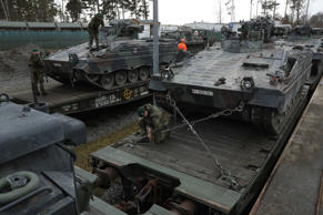 Soldiers of the Bundeswehr, the German armed forces, secure Marder light tanks on trains for transport to Lithuania on February 21, 2017 in Grafenwoehr, Germany. The Bundeswehr is participating in the enhanced Forward Presence operation of NATO, in which multinational contingents are strengthening the defensive capabilities of the three Baltic states and Poland in light of Russia's recent interventions in Crimea and eastern Ukraine.