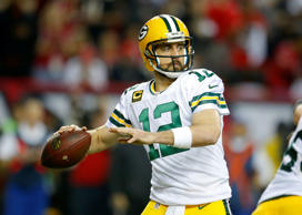 Packers quarterback Aaron Rodgers (12) drops back to pass in the first half of the NFC Championship game between the Green Bay Packers and Atlanta Falcons on January 22, 2017, at the Georgia Dome in Atlanta, GA. The Atlanta Falcons won the game 44-21.