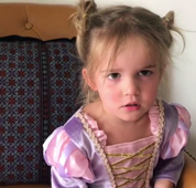 Little girl distinctly unimpressed with Disneyland