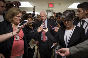 Senator John McCain (C) is surrounded by reporters asking about the state of the...