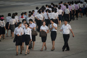 A photo taken on July 24, 2017 shows a group of university students walking on a street in Pyongyang.