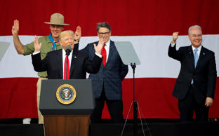 President Donald Trump, front left, gestures with former boys scouts, Interior Secretary Ryan Zinke, left, Energy Secretary Rick Perry, center, and Secretary of Health and Human Services Tom Price, right, at the 2017 National Boy Scout Jamboree at the Summit in Glen Jean,W. Va., Monday, July 24, 2017.