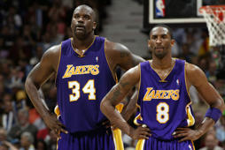 Shaquille O'Neal (L) and Kobe Bryant of the Los Angeles Lakers stand on the court while playing againt the Minnesota Timberwolves in Game Five of the Western Conference Finals on May 29, 2004 at Target Center in Minneapolis, Minn.