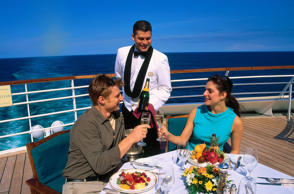 Couple eating meal on cruise ship