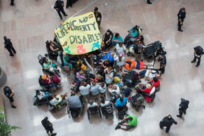 Demonstrators gather in the atrium of Hart Building to protest the Senate's heal...
